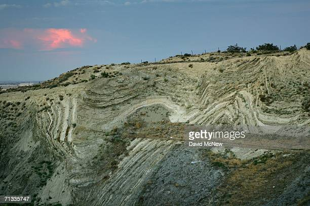 Layers of earthquake-twisted ground are seen at dusk where the 14 freeway crosses the San Andreas Fault on June 28, 2006 near Palmdale, California....