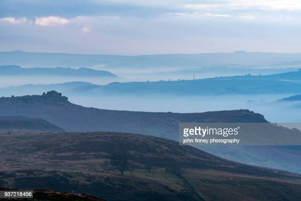 Layers of hills in the mist, Peak District National park, UK