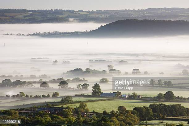 layers of mist and fog across somerset levels at glastonbury, somerset, england, uk - 2010 stock pictures, royalty-free photos & images