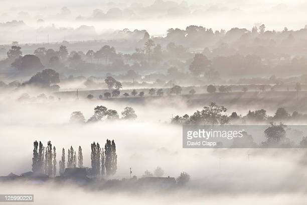 layers of mist and fog across somerset levels at glastonbury, somerset, england, uk - september stock pictures, royalty-free photos & images