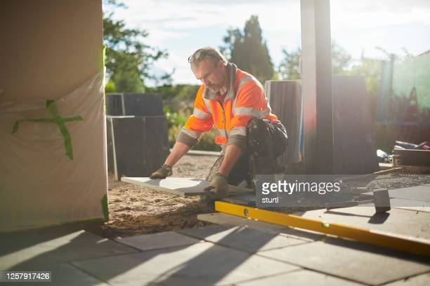 laying a patio in slate - paving stone stock pictures, royalty-free photos & images