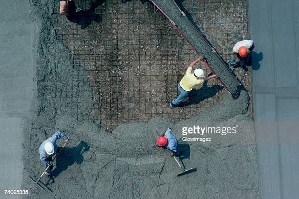 laying cement for road construction - paving stone stock pictures, royalty-free photos & images