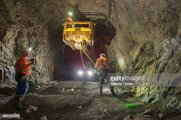 laying explosives underground - underground mining stock photos and pictures
