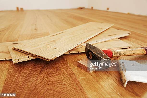 Laying finished parquet flooring, close-up