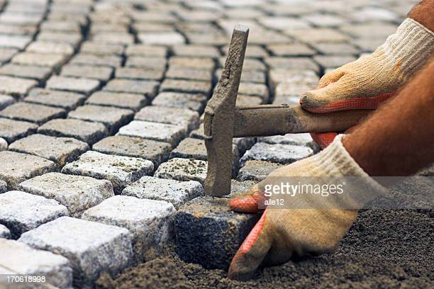 laying of stone cubes - granite stock pictures, royalty-free photos & images