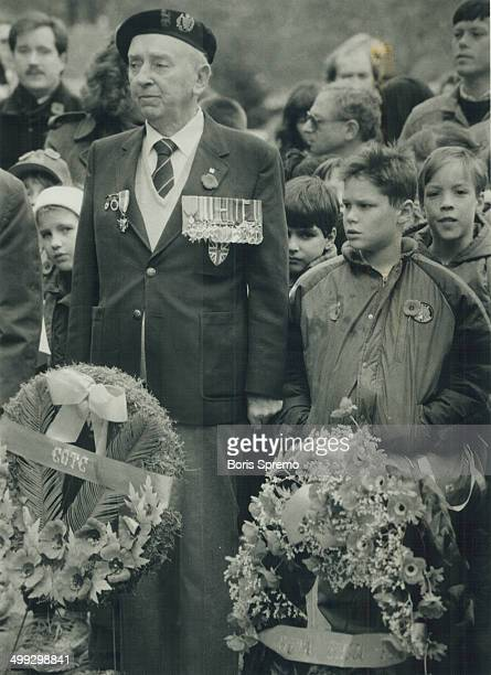 Laying of wreaths Brigadier General JF Westhead is surrounded by schoolchildren at a Remembrance Day service on the University of Torono campus...