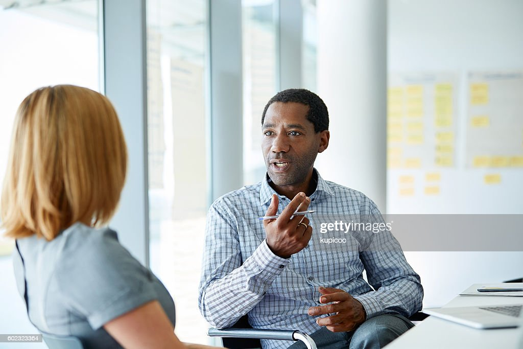 Laying out his plan : Stock Photo