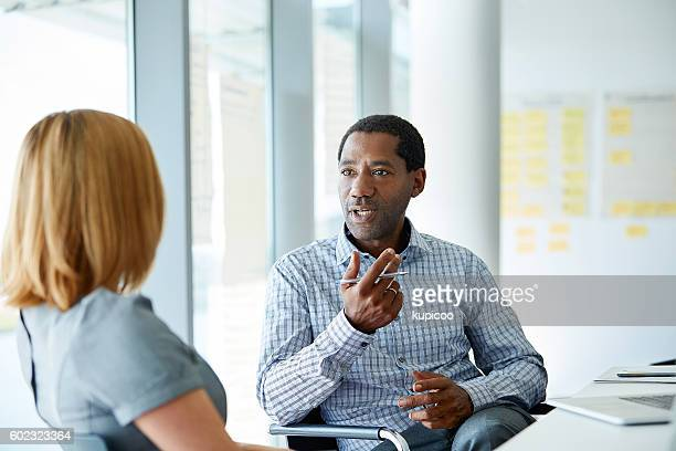 laying out his plan - two people stock pictures, royalty-free photos & images