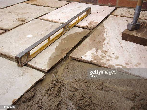 laying patio flag paving slab - sandstone stock pictures, royalty-free photos & images