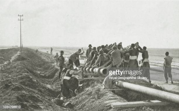 Laying pipeline from the Persian oilfields to Abadan Refinery Iran circa 1928