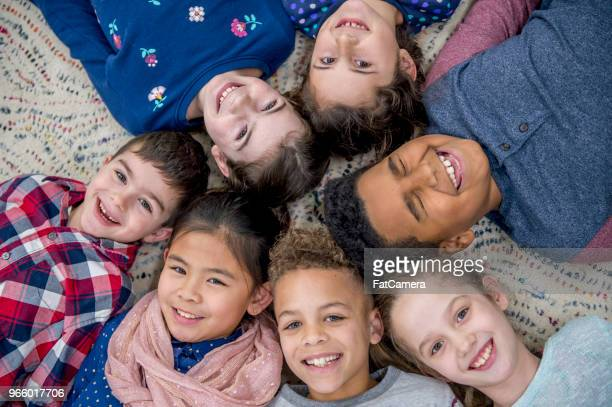 laying together in classroom - class photo stock photos and pictures