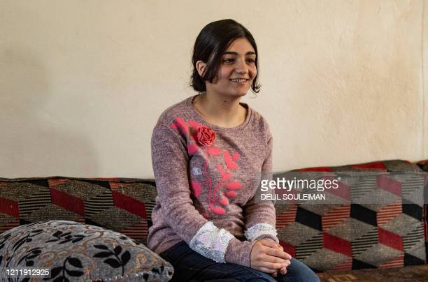 Layla Eido a teenager from Iraq's minority Yazidi community is pictured in the countryside of Syria's northeastern province of Hasakeh on April 23...