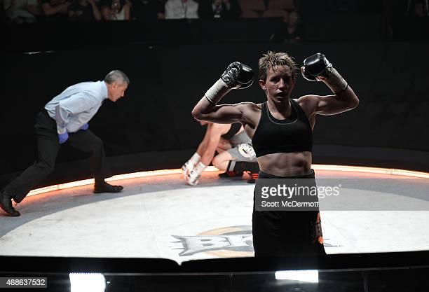 Layla McCarter celebrates her win over Diana Prazak during BKB 2 Big Knockout Boxing at the Mandalay Bay Events Center on April 4 2015 in Las Vegas...