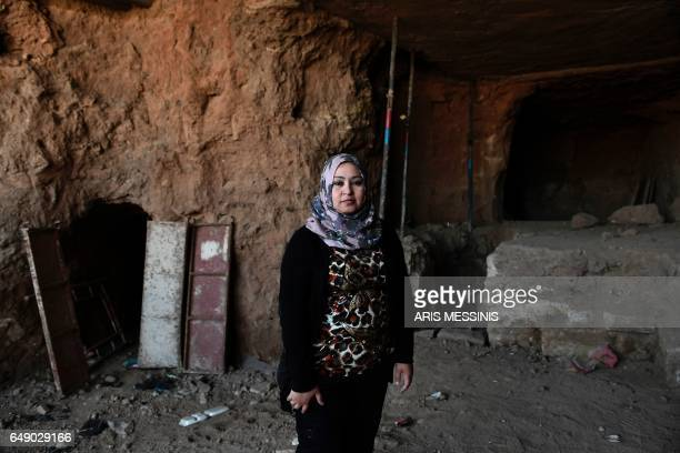 Layla Salih head of Antiquities for the province of Nineveh of which Mosul is the capital poses in front of an underground tunnel in east Mosul on...