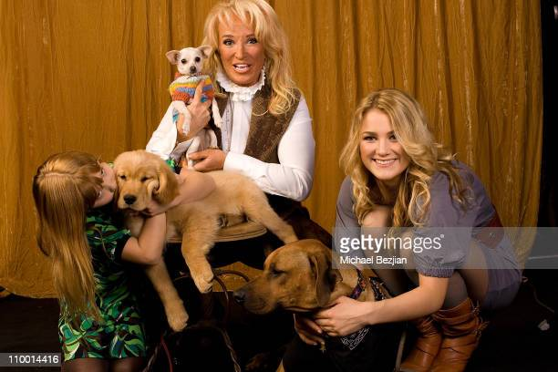 Layla Tucker and actresses Tanya and Pressly Tucker pose with their dogs at the Main Event Red Carpet Lounge and Green Suite on February 22 2008 in...