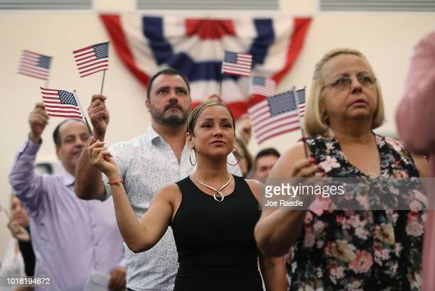 Laymit Caballero orginally from Cuba participates in a ceremony to become an American citizen during a US Citizenship Immigration Services...