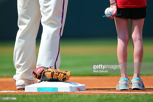 Laynce Nix of the Philadelphia Phillies stands at first base with a young fan before the start of their MLB baseball game against the New York Mets...