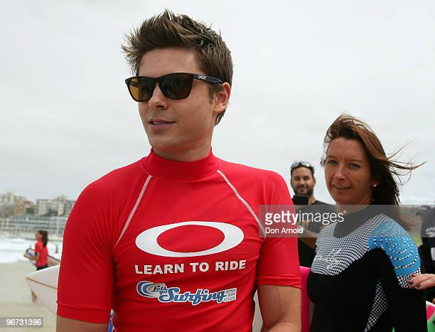 Layne Beachley and Zac Efron attend Oakley's 'Learn To Ride' charity learntosurf event in aid of the One Sight Foundation at Bondi Beach on February...