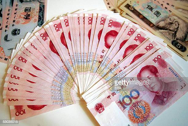 A layout showing various denominations of the Chinese yuan in Beijing 08 June 2005 China's major trading partners have been pressing it to make its...