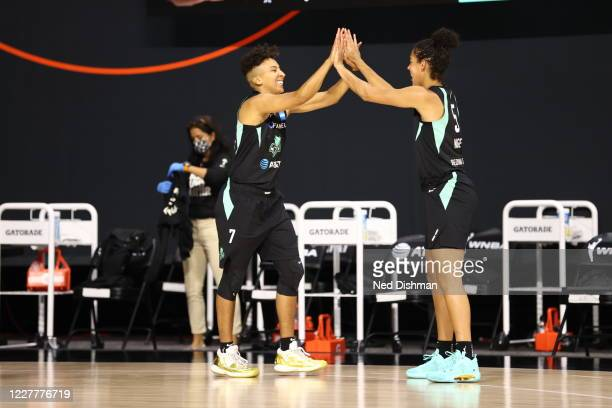 Layshia Clarendon and Kia Nurse of New York Liberty hi-five during a game against the Seattle Storm on July 25, 2020 at Feld Entertainment Center in...