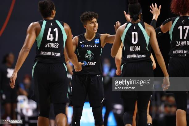Layshia Clarendon of New York Liberty high-fives teammates during the game on August 7, 2020 at the Feld Entertainment Center, in Palmetto, Florida....