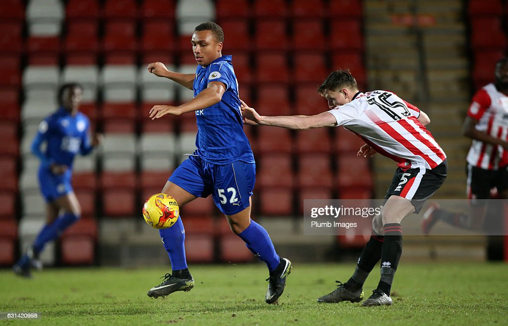 Layton Ndukwu of Leicester City in action with William Boyle of Cheltenham Town during the EFL Checkatrade Trophy Second Round tie between Cheltenham Town and Leicester City at Whaddon Road Stadium on January 10, 2017 in Cheltenham, England.
