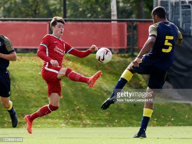 Layton Stewart of Liverpool and David Okagbue of Stoke City in action during the U18 Premier League game at The Kirkby Academy on September 19 2020...