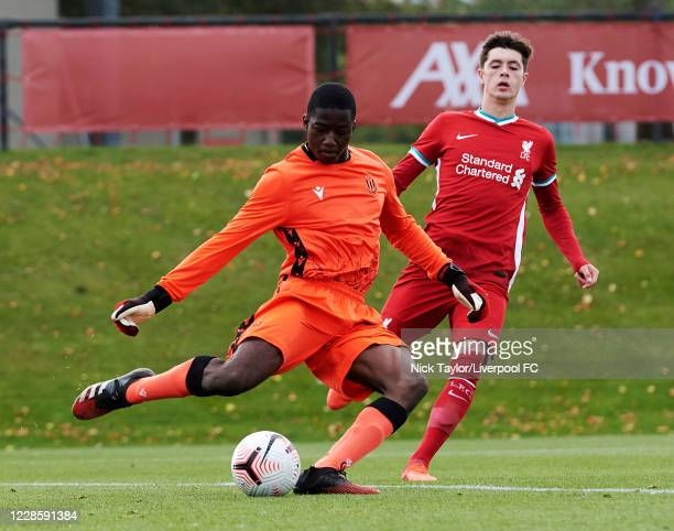 Layton Stewart of Liverpool and Paul Cooper of Stoke City in action during the U18 Premier League game at The Kirkby Academy on September 19 2020 in...