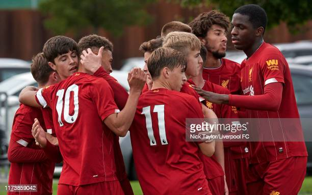 Layton Stewart of Liverpool celebrates scoring from the penalty spot with Fidel O'Rourke and other team mates during the U18 Premier League game at...