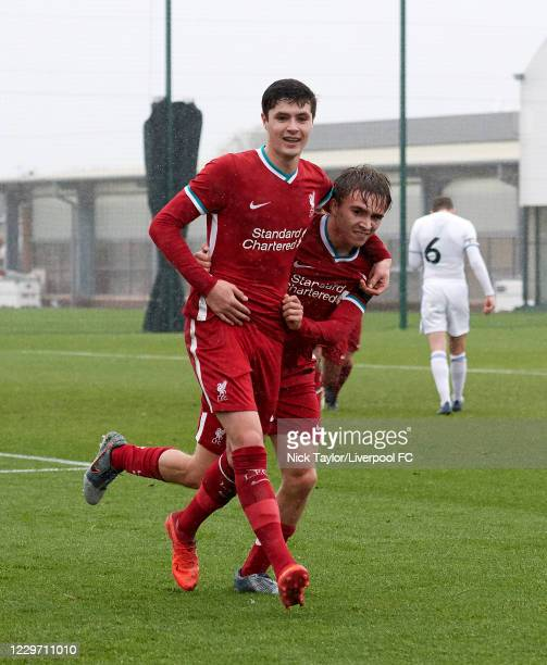 Layton Stewart of Liverpool celebrates scoring Liverpool's second goal with team mate James Norris at Melwood Training Ground on November 21, 2020 in...