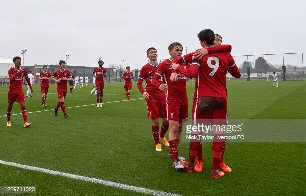 Layton Stewart of Liverpool celebrates scoring Liverpool's second goal with team mates at Melwood Training Ground on November 21, 2020 in Liverpool,...