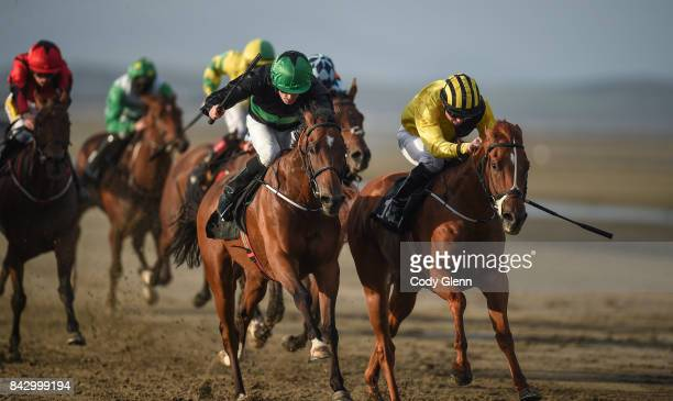 Laytown Ireland 5 September 2017 Eventual winner Tom Dooley front left with Billy Lee up race ahead of Arlecchino's Rock with Colm O'Donoghue up who...