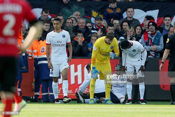Layvin Kurzawa and Kevin Trapp of Paris SaintGermain during the French League 1 match between EA Guingamp and Paris SaintGermain on April 9 2016 in...