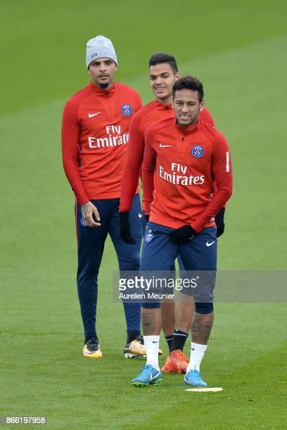 Layvin Kurzawa Hatem Ben Arfa and Neymar Jr of Paris SaintGermain warm up during a Paris SaintGermain practice session at Centre Ooredoo on October...