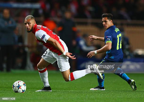 Layvin Kurzawa of Monaco evades Alexis Sanchez of Arsenal during the UEFA Champions League round of 16 second leg match between AS Monaco and Arsenal...
