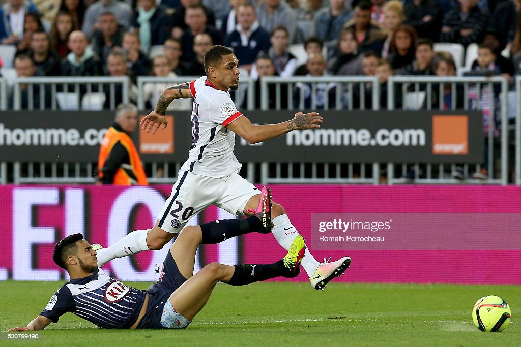 Layvin Kurzawa of Paris Saint Germain and Adam Ounas of Girondins de Bordeaux battle for the ball during the French Ligue 1 match between FC Girondins de Bordeaux and Paris Saint-Germain at stade Matmut Atlantique on May 11, 2016 in Bordeaux, France.