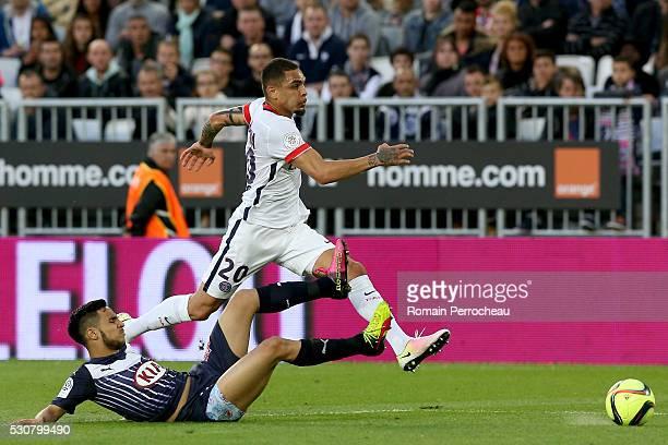 Layvin Kurzawa of Paris Saint Germain and Adam Ounas of Girondins de Bordeaux battle for the ball during the French Ligue 1 match between FC...