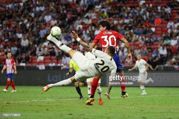 Layvin Kurzawa of Paris Saint Germain and Roberto Olabe of Atletico Madrid challenge for the ball during the International Champions Cup 2018 match...