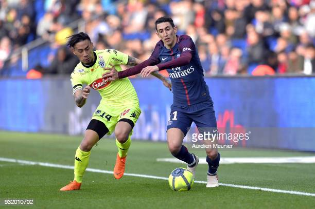 Layvin Kurzawa of Paris SaintGermain and Billy Ketkeophomphone of Angers SCO fight for the ball during the Ligue 1 match between Paris Saint Germain...