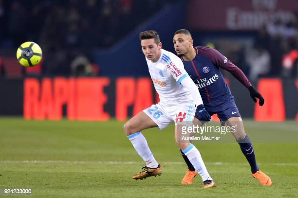 Layvin Kurzawa of Paris SaintGermain and Florian Thauvin of Olympique de Marseille fight for the ball during the Ligue 1 match between Paris Saint...