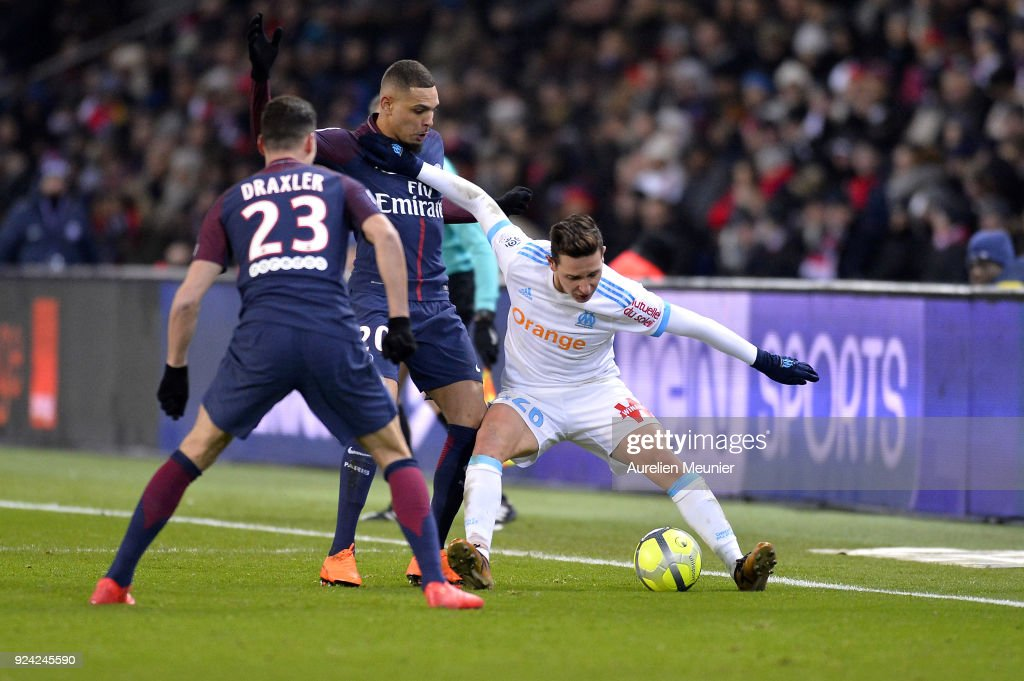 Layvin Kurzawa of Paris Saint-Germain and Florian Thauvin of Olympique de Marseille fight for the ball during the Ligue 1 match between Paris Saint Germain and Olympique Marseille February 25, 2018 in Paris, France.