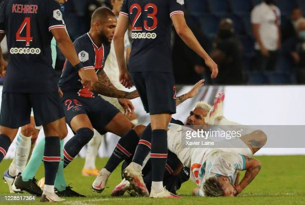 Layvin Kurzawa of Paris SaintGermain eject Dario Benedetto of Olympique de Marseille and receive a red card for this fault during the Ligue 1 match...