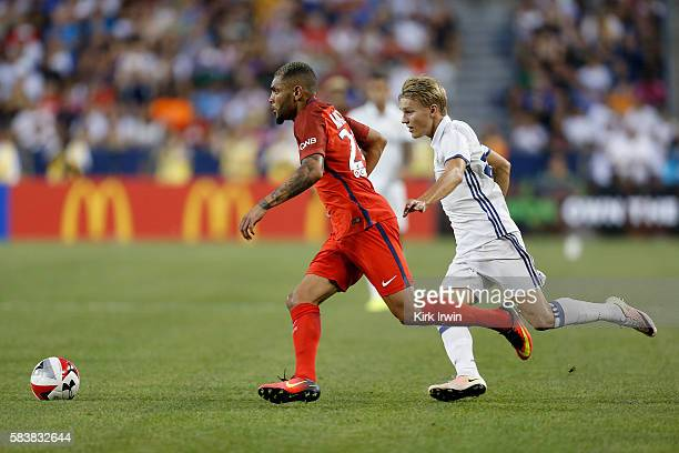 Layvin Kurzawa of Paris SaintGermain FC and Martin Odegaard of Real Madrid CF chase after the ball during the second half on July 27 2016 at Ohio...