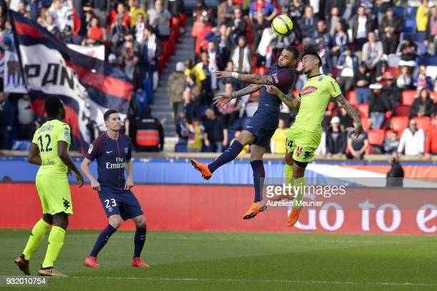 Layvin Kurzawa of Paris SaintGermain jumps for the ball during the Ligue 1 match between Paris Saint Germain and Angers SCO at Parc des Princes on...