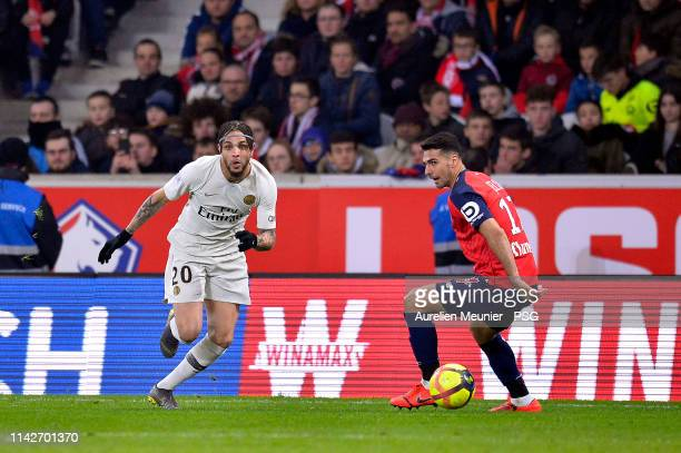 Layvin Kurzawa of Paris SaintGermain runs with the ball during the Ligue 1 match between Paris SaintGermain and Lille OSC at Stade Pierre Mauroy on...