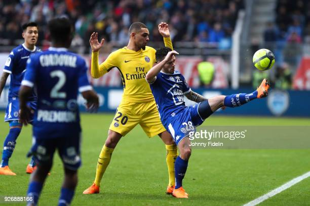 Layvin Kurzawa of PSG and Bryan Pele of Troyes during the Ligue 1 match between Troyes AC and Paris Saint Germain at Stade de l'Aube on March 3 2018...