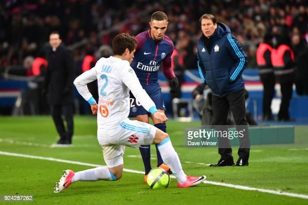 Layvin Kurzawa of PSG and Hiroki Sakai of Marseille during the Ligue 1 match between Paris Saint Germain and Olympique Marseille at Parc des Princes...