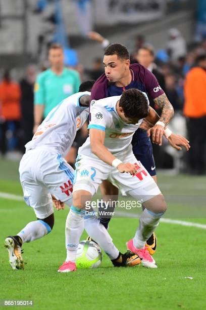 Layvin Kurzawa of PSG cannot get past Hiroki Sakai of Marseille and Bouna Sarr of Marseille during the Ligue 1 match between Olympique Marseille and...