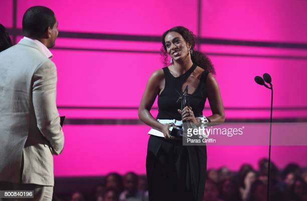 Laz Alonso and Solange onstage as she accepts the Centric Award for 'Cranes In The Sky' at 2017 BET Awards at Microsoft Theater on June 25 2017 in...