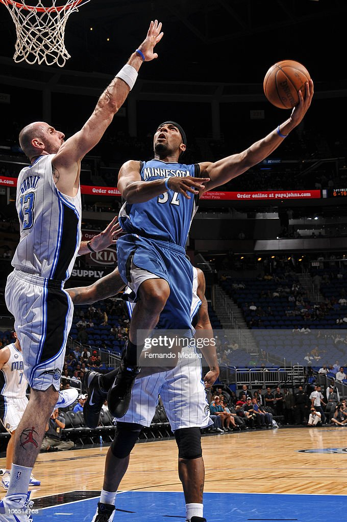 Lazar Hayward #32 of the Minnesota Timberwolves shoots against Marcin Gortat #13 of the Orlando Magic on November 3, 2010 at the Amway Center in Orlando, Florida.